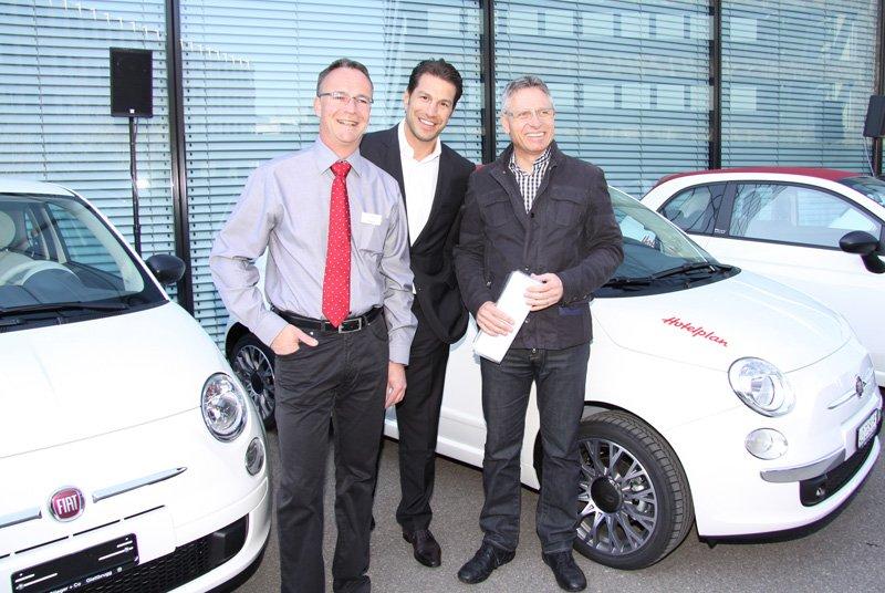 D. Reinhard, Director Retail Hotelplan Suisse, M. Parroni Sales Director Fiat Group Automobiles Switzerland SA, Ch. Stieger propriétaire Fiat Garage Stieger & Co